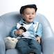 05 Easter Special: boy in hat blue chair with bunnies