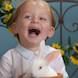 laughing baby portrait with easter bunny