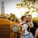 columbia missouri wedding photographer: groom and bride with tractor