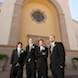 columbia missouri wedding photographer: groomsmen in front of church