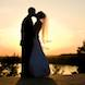 columbia missouri wedding photographer: kiss by bride groom in setting sun