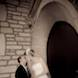jefferson city missouri wedding photographer: bride groom kiss in church vestibule